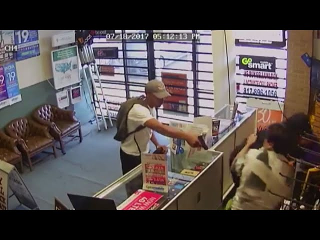CCTV shows men fight off armed robbers barehanded