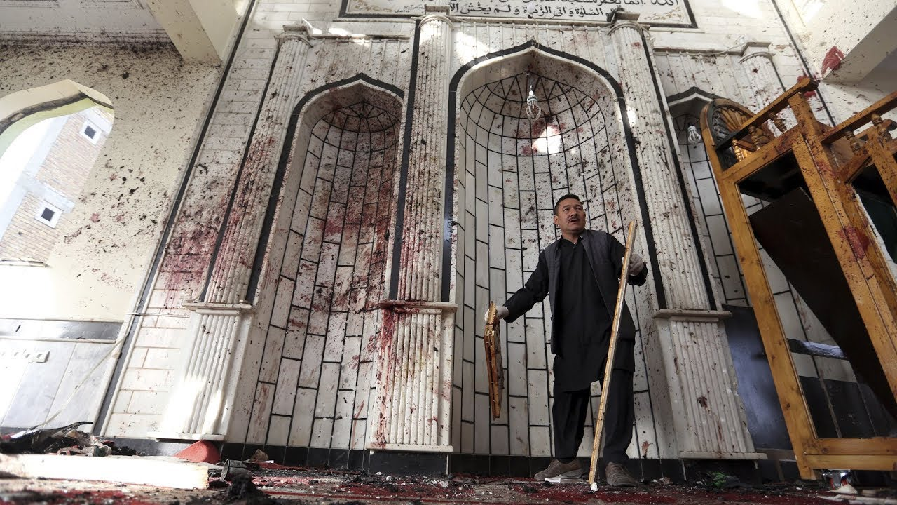 At least 72 dead after suicide bombers attack Afghan mosques