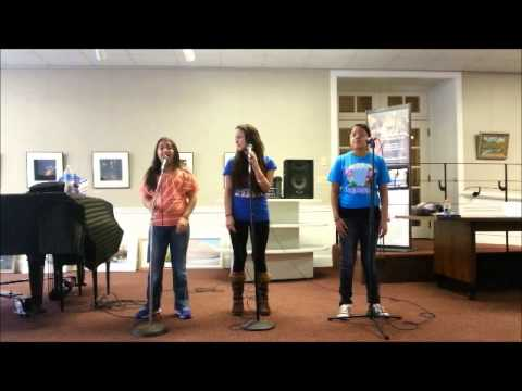 "Trinity singing ""To Know Know Know Him"" by Dolly Parton, Linda Ronstadt, and Emm"