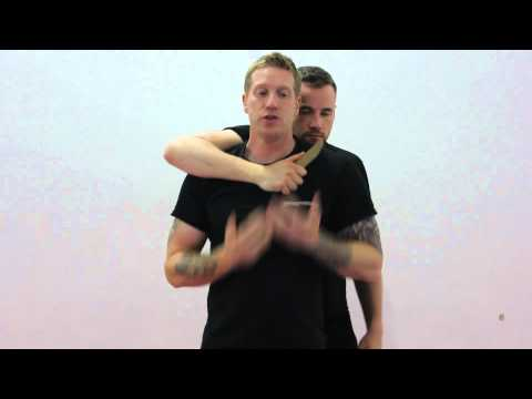 Krav Maga Techniques - Defending a knife threat from the rear Image 1