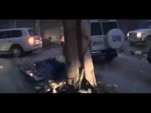 Syria crisis: Homs aid convoy comes under fire