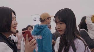 Two Korean high-school girls at Namsan Seoul Tower