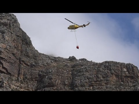 Large helicopters try put out threatening wildfire above Muizenberg