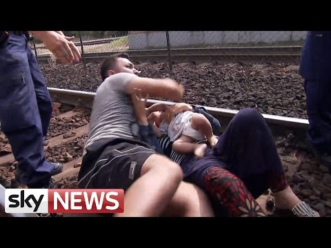 Migration Crisis: Desperate Father Pulls Family Onto Train Tracks