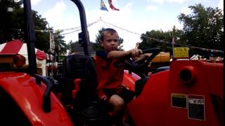 Louie driving a tractor