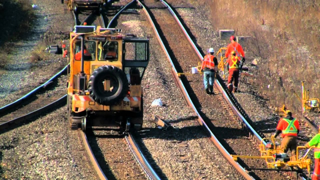 M O W Crews Repair And Replace Rails As Trains Pass By At