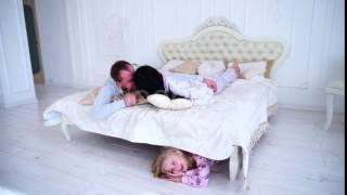 Daughter Hiding Under Bed, Mom and Dad Kiss and Looking For Kid at Home