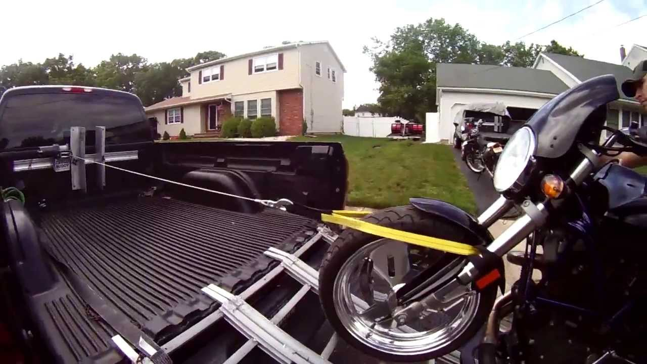 Buell Motorcycle Loading Into Pickup Using Cargo Buddies