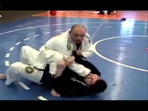 BJJ Techniques: Scissor Sweep to Bow & Arrow Choke Image 1