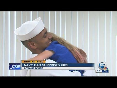 Navy dad surprise kids