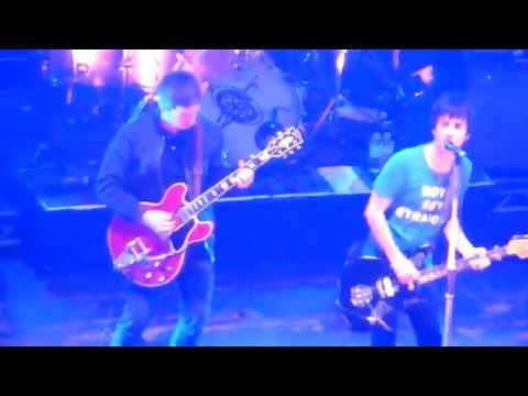 Johnny Marr and Noel Gallagher on stage at Brixton Academy