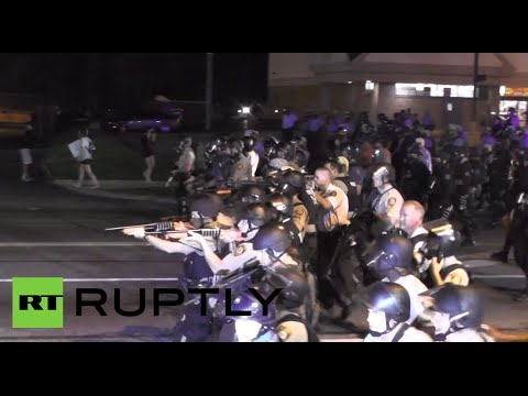 Police point weapons at protesters in Ferguson as tension still high