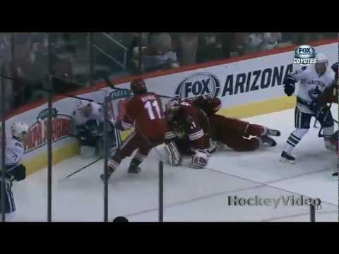 Alex Edler charging major on Mike Smith . Mar 21, 2013