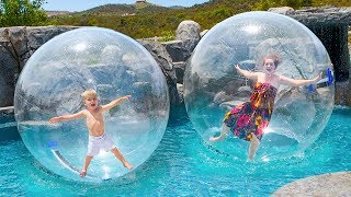 FUN IN GIANT BUBBLE BALL! WALKING ON WATER IN NEW SWIMMING POOL!