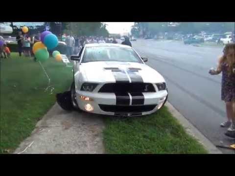 Mustang tries to show off, but crashes into crowd instead