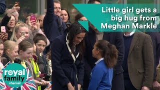 Little girl gets a big hug from Meghan Markle in Birmingham