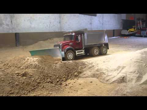 My Mack dump truck pushing dirt with a snow plow blade.
