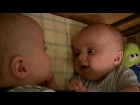 Twin Baby Boys Laughing at Each Other