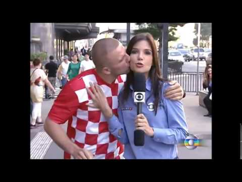 Croatian fan kisses Brazilian reporter on live 12.06.2014