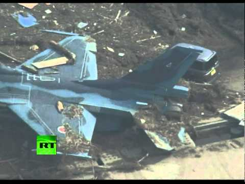 Video of fighter jets in mud after tsunami hits Japan Air Force base