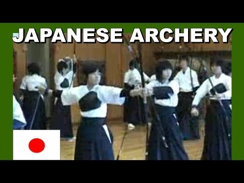 0 Japanese high school girls practicing Kyudo way of the bow archery.