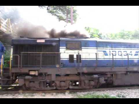 A KJM WDG3A 13034(that started serivce sometime in 2003) belches out huge amounts of smoke as it departs from Malleshwaram Station towards SBC, with the Hind...