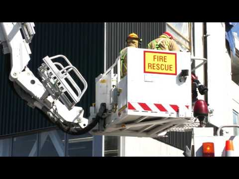 Two injured after crane topples