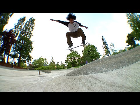 SKATEBOARDING IN A DRAINED FOUNTAIN