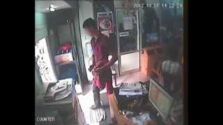 Mobile phone theft caught on security cam (CCTV) in Thrissur