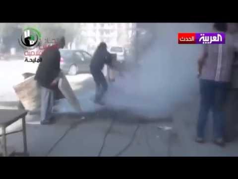 image vidéo  قوات النظام السوري حرقت الجثث وألقتها في الشوارع