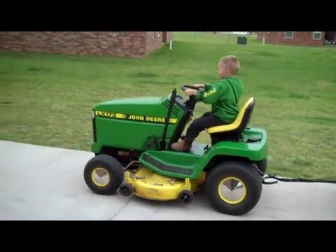 Hayden drives his LX173.. He&#039;s 4 in this video.. Updated, Hayden at 6 with a JD4310 and utility trailer. - http://youtu.be/0hzJ9sWIPJ0.