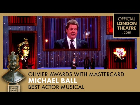 Michael Ball collects the 2013 Olivier Award for Best Actor in a Musical for his performance in Sweeney Todd. Queen's Brian May presents the award.