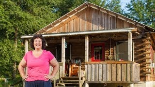 Mortgage Free for Life. Inspiring women shows how to build a log cabin by hand.