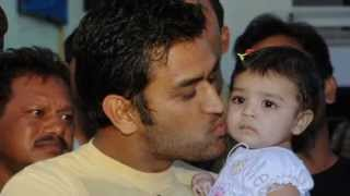 Ms Dhoni with his daughter