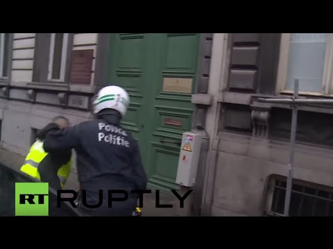 Belgium: Furious taxi drivers light fires outside European Commission