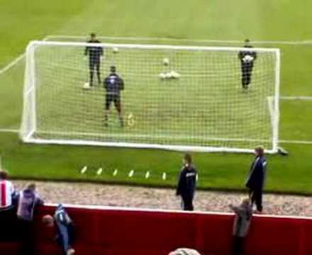 Exeter City number 1 makes a great save in pre-match training.