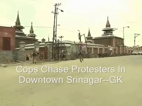 Police Chase Protesters In Downtown Srinagar