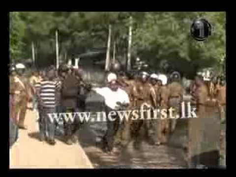 Police use tear gas to disperse the demonstrators in Badulla