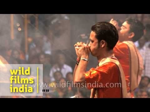 Priests blow conch shell 'Shankh' before Ganga aarti at Banaras