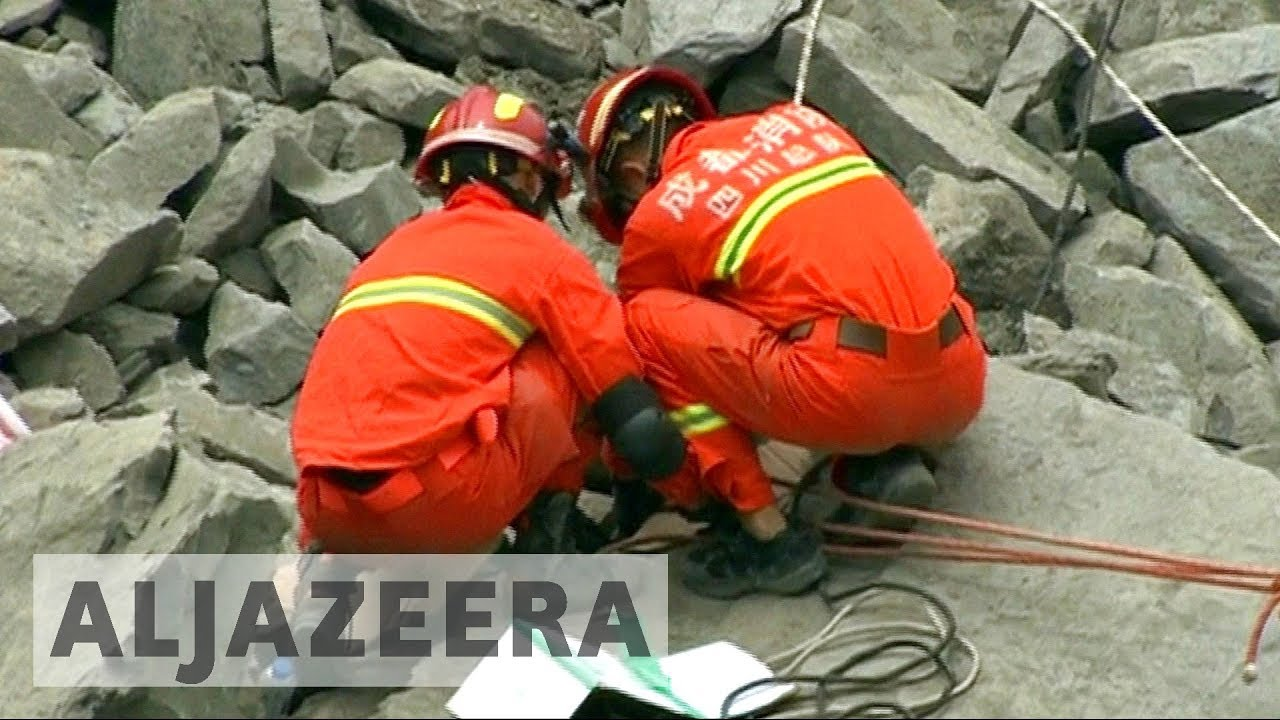 Scores missing as search for China landslide survivors continues