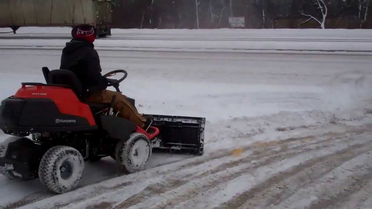 Husqvarna Articulating Mower Using Nordic Plow In Snow