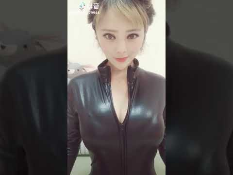 latex catsuit with big boobs thumbnail