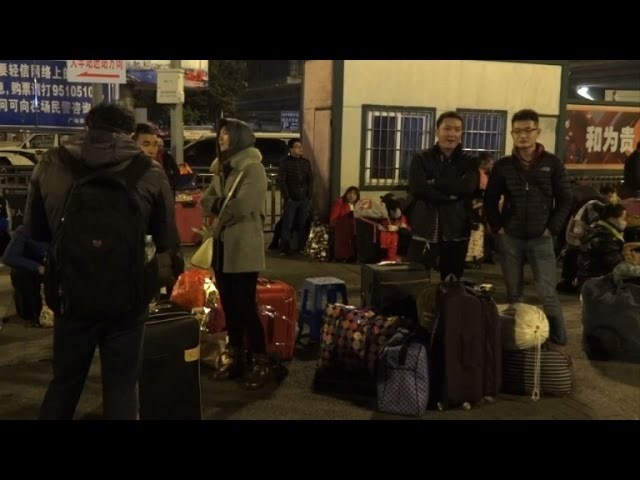 Tens of thousands of Chinese new year travellers stranded