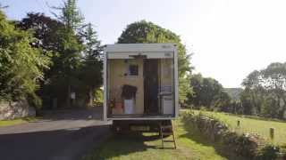 Couple pack it all in and move into their new mobile home - an old white van