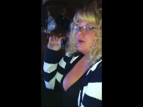 Sexy woman enjoying a large cigar