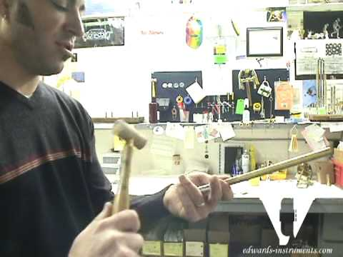Christan Griego takes us through the procedure of removing a stuck mouthpiece and leadpipe from a trombone slide that features a removable leadpipe.