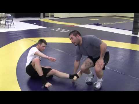 MMA Grappling Technique - Inside trip from 50-50 Clinch Image 1