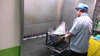 the Spray Painting Operation within a Painting Booth & Fixture Stand supplied by JMTC - 02
