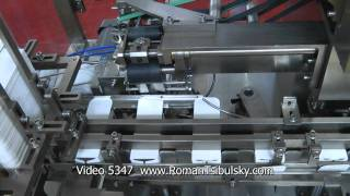 Automatic Cartoning Machine. Packaging of plastic vials with tablets or capsules in carton  boxes