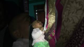 Cute baby laughing in a bengali conversation
